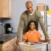 Father and son with laundry basket