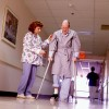 Nurse Helping Old Man on Crutches
