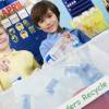 children recycle together in the classroom