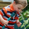 boy drinking water from hose