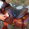 Figure 2.  Particularly dirty saddles may be ?scrubbed? using saddle soap and water. A good rule of thumb for selecting a brush is to select one with plastic bristles that would be appropriate for cleaning your fingernails.