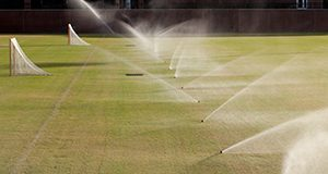 Sprinklers watering athletic fields.
