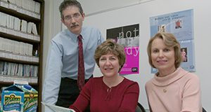 Ron Lutz, left, Gail Rampersaud and Lynn Bailey review educational materials developed by the Florida Folic Acid Coalition to promote awareness about the health benefits of the vitamin. Lutz, an advanced registered nurse practitioner, is a coordinator for the coalition based at the University of Florida's Institute of Food and Agricultural Sciences. Rampersaud, a registered dietitian and assistant in nutrition research and education, and Bailey, a professor in the food science and human nutrition department, oversee the coalition.