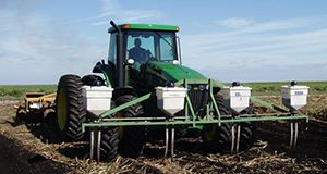 Application of granular insecticide for control of wireworms at sugarcane planting.