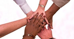 Teamwork hand shake.