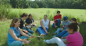 At Paynes Prairie Preserve State Park, Nassau County Extension Director, Mary Williams, socializes with 4-H youth from across the state during 4-H Congress in July 2003.