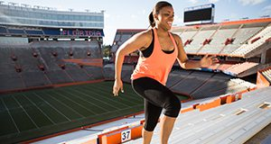 Women running up stadium steps for exercise. Image used in the 2014 Research Discoveries report.