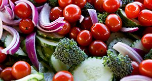 Cherry tomatoes, cucumbers, broccoli and onions in a fresh salad. Food, vegetables, healthy eating. UF/IFAS Photo by Tyler Jones.