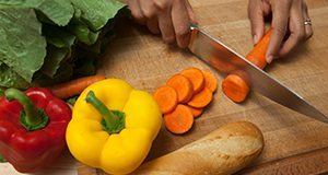 Cutting vegetables and food preparation.