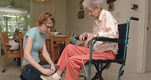 Elderly person receiving assistance from a caregiver with everyday tasks. UF/IFAS Marisol Amador