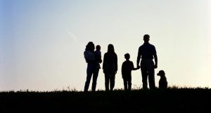 family sillouhetted against horizon