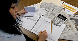 Using IFAS-generated budgeting tools, young people can learn to manage their money and begin saving and investing in the future. UF/IFAS Photo: Tyler Jones. IFAS Extension calendar 2009
