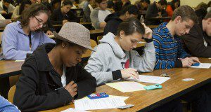 Students in a classroom taking a test. Image used in the 2014 Research Discoveries report.