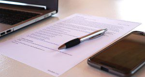Contract with office equipment. Image by TheDigitalWay from Pixabay