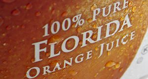 close-up photo of an orange juice label reading 100% PURE FLORIDA ORANGE JUICE